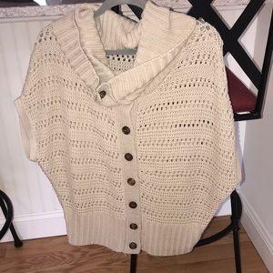 Shrug cream colored sweater.